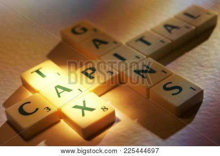Cleckheaton, West Yorkshire, Uk: Scrabble Board Game Letters Spelling The Words Tax Capital Gains, 1