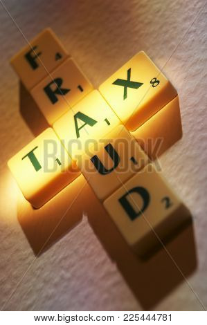Cleckheaton, West Yorkshire, Uk: Scrabble Board Game Letters Spelling The Words Tax Fraud, 1st June