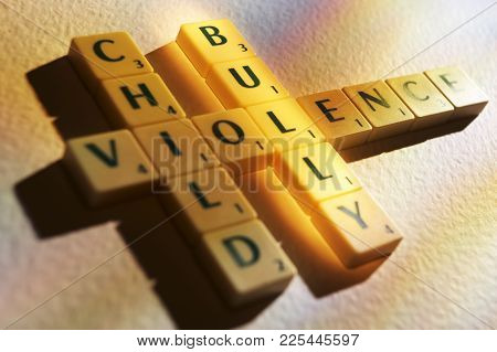 Cleckheaton, West Yorkshire, Uk: Scrabble Board Game Letters Spelling The Words Violence Child Bully
