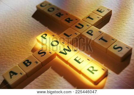 Cleckheaton, West Yorkshire, Uk: Scrabble Board Game Letters Spelling The Words Absolute Power Corru