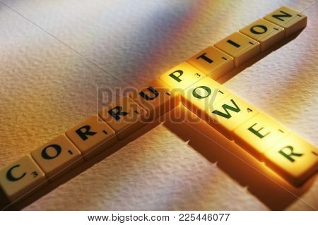 Cleckheaton, West Yorkshire, Uk: Scrabble Board Game Letters Spelling The Words Corruption Power, 1s