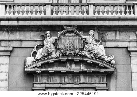 Barcelona,spain-september 4,2017:detail Main Entrance Ancient Medieval Foundry, Sculpture Allegory O