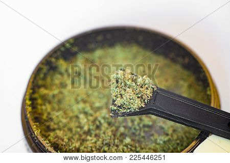 Kief In Grinder For Weed Macro Top View Isolated On White Backgrou