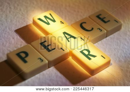 Cleckheaton, West Yorkshire, Uk: Scrabble Board Game Letters Spelling The Words War Peace, 1st June