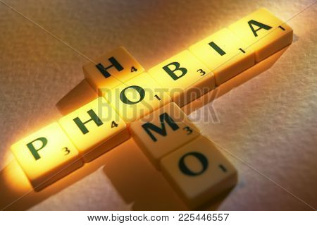 Cleckheaton, West Yorkshire, Uk: Scrabble Board Game Letters Spelling The Words Homo Phobia, 1st Jun