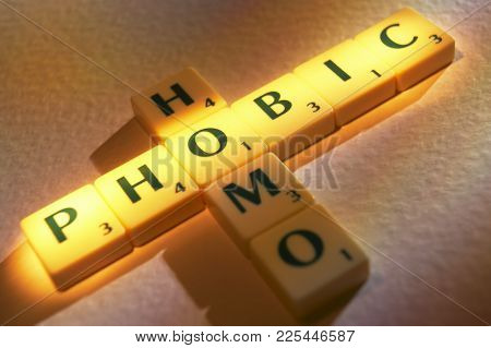 Cleckheaton, West Yorkshire, Uk: Scrabble Board Game Letters Spelling The Words Homo Phobic, 1st Jun