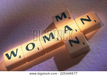 Scrabble Board Game Letters Spelling The Words Man And Woman