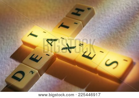 Cleckheaton, West Yorkshire, Uk: Scrabble Board Game Letters Spelling The Words Death Taxes, 1st Jun