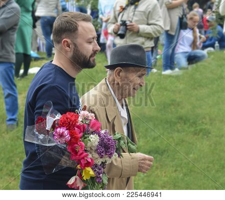 Pyatigorsk, Russia - May 09, 2017: Young Man Supports An Elderly Man On Victory Day On A Parade Of 9