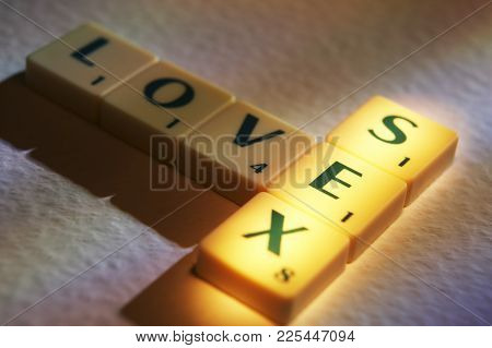 Cleckheaton, West Yorkshire, Uk: Scrabble Board Game Letters Spelling The Words Love Sex, 1st June 2