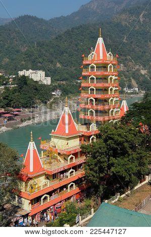 Rishikesh, India - November, 4th, 2017. View Of Ganga River Embankment And Tera Manzil Temple, Trimb