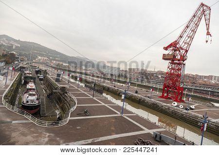 Bilbao,spain-january 12,2017:maritime Museum Exterior With Big Crane Next To Estuary, Bilbao.