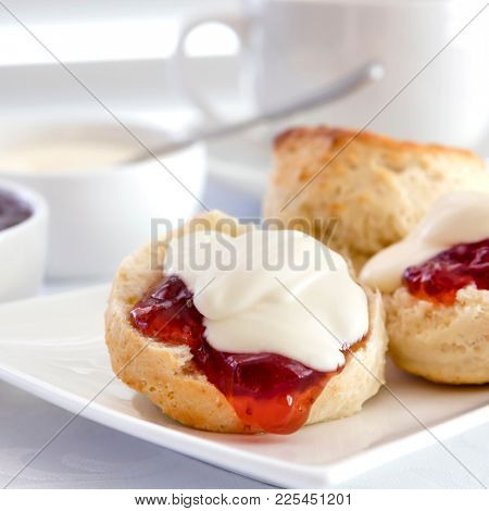 Scones with strawberry jam and cream.  Traditional English or Devonshire tea.
