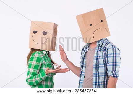 Disappointed Man With Bags Over Heads Rejecting His Woman