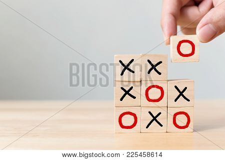 Business Marketing Strategy Planning Concept. Wooden Block Tic Tac Toe Board Game On Wood Table