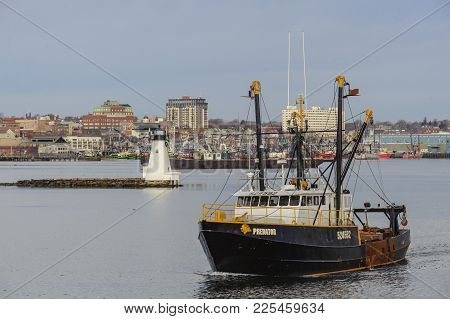 Commercial Fishing Vessel Predator With New Bedford Waterfront In Background