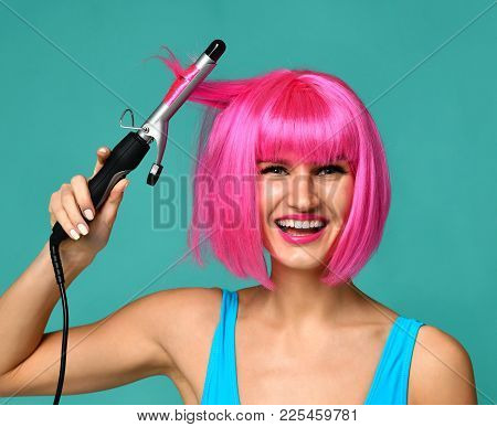 Happy Woman In Pink Wig With Iron Ceramic Hair Curler Professional Curling Wand On Blue Mint Backgro
