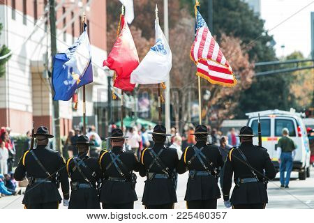 Atlanta, Ga - November 2017:  A Color Guard Of Six Uniformed Men Presents The Colors While Walking I