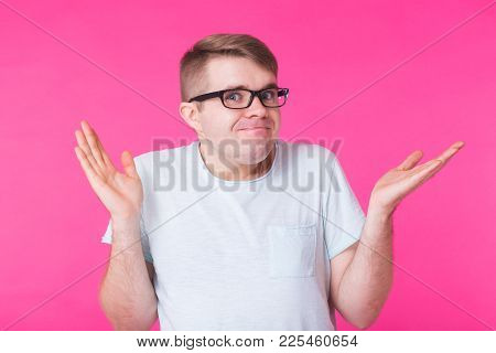 Doubtful Caucasian Man With Gestures In Uncertainty, Confused And Puzzled, Looks Directly Into Camer