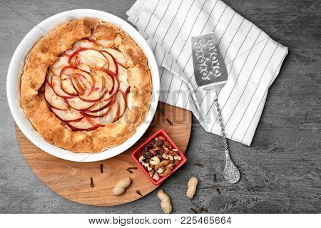 Composition with tasty apple tart on table, top view