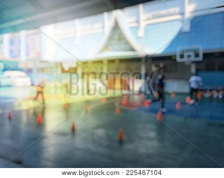Blurred image of children or male and female students in secondary school are learning football or s