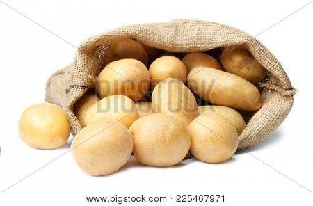 Sack of fresh raw potatoes on white background