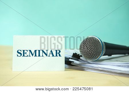 Close Up Microphone On Paper Document With Seminar Text, Concept Of Speaker Or Teacher Preparation T