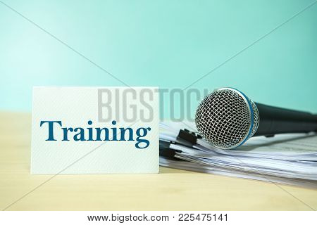 Close Up Microphone On Paper Document With Training  Text, Concept Of Speaker Or Teacher Preparation