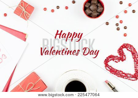 Happy Valentine's Day Greeting Card With Coffee, Sweets And Giftbox In Background.