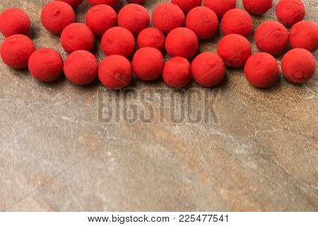 Boilies For Carp Fishing Lie On A Stone Countertop