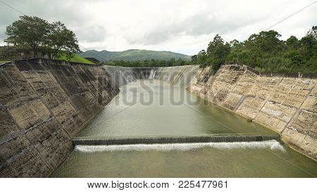 Dam On The Lake In The Rainforest On The Island. Water Flowing From The Dam, Water For Irrigation Co
