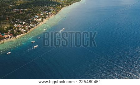 Aerial View Of Beautifulisland With White Sand Beach, Moalboal, Boats, Hotels And Tourists. Tropical