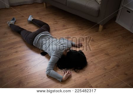 murder, kill and people concept - dead woman body in blood lying on floor at crime scene (staged photo)
