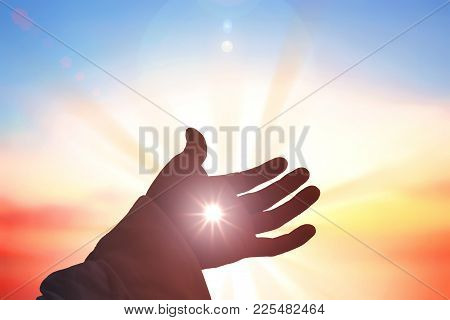 Healing From God Concept: Silhouette Christian Open Spiritual Hands With Palms Up Over Blurred New D