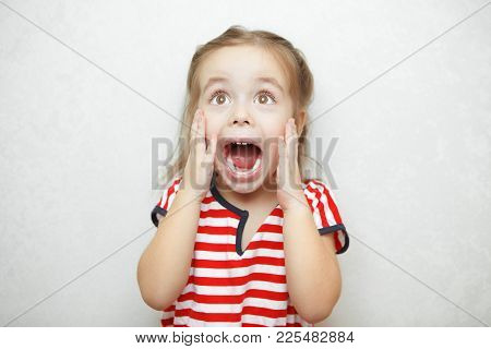 Girl Experiencing And Expressing Emotion Of Fright And Fear By Placing Hands On Face, Opening Mouth