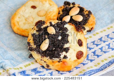 Three Yeast Cake With Almond, Poppy, Raisin, And Cheese On Towel, Close Up