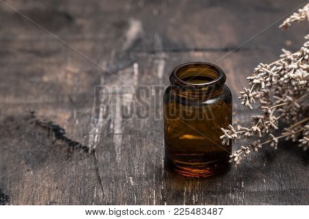 Essential Oils And Lavender On Wooden Table. Lavender Spa, Wellness With Lavender