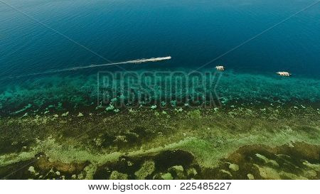 Aerial View Of Motor Boat In Sea. Aerial Image Of Motorboat Floating In A Turquoise Blue Sea Water.