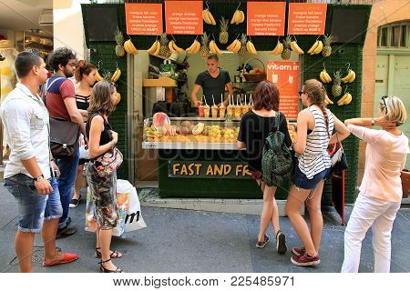 Aix-en-provence, France - July 1, 2017. People Near The Stall With Fresh Fruit Cocktails. Fresh Piec