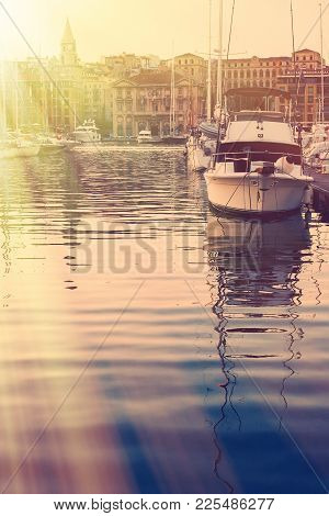 Old Port Of Marseille. Yacht In The Rays Of The Rising Sun.