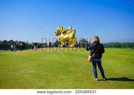 Chiang Rai, Thailand - December 23, 2017: Woman Preparing To Take A Photo Singha Figure In Singha Pa