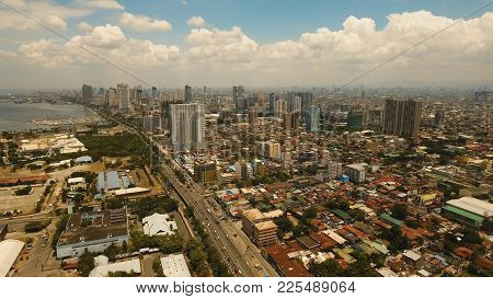 Aerial View Of Manila City. Fly Over City With Skyscrapers And Buildings. Aerial Skyline Of Manila.