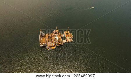 Dredge Ship Presumably Performing Harbor And Channel Maintenance. Aerial View: Huge Crane Barge Indu