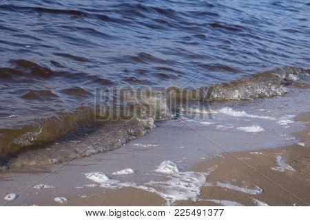 Sea Coastal Zone Small Pebbles And Surf Background