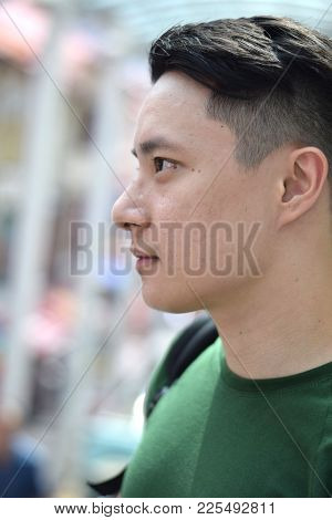 A Side Profile Of A Handsome Young Asian Chinese Male