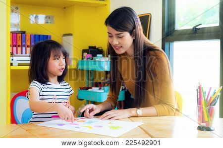 Asian Lady Teacher Teach About Drawing And Art Subject To Her Student On Table In Class Room In Pres