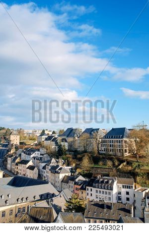 a view of the Grund Quarter in Luxembourg City, Luxembourg, with its typical houses with black slate roofs