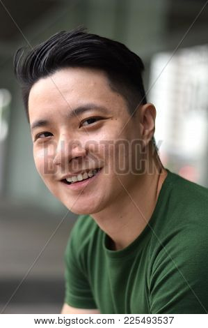 A Young Handsome Asian Male Chinese Smiling At Camera