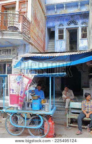Chittorgarh, Rajasthan, India - December 13, 2017: Street Scene With A Shopkeeper Preparing Masala C