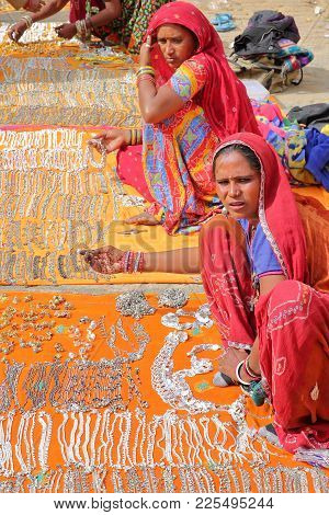 Jaisalmer, Rajasthan, India - December 20, 2017: Portrait Of Women With Colorful Dress And Wearing J